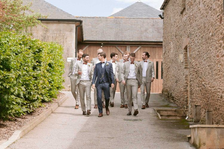 Groom with groomsmen wearing matching suits and bowties at Shilstone House wedding