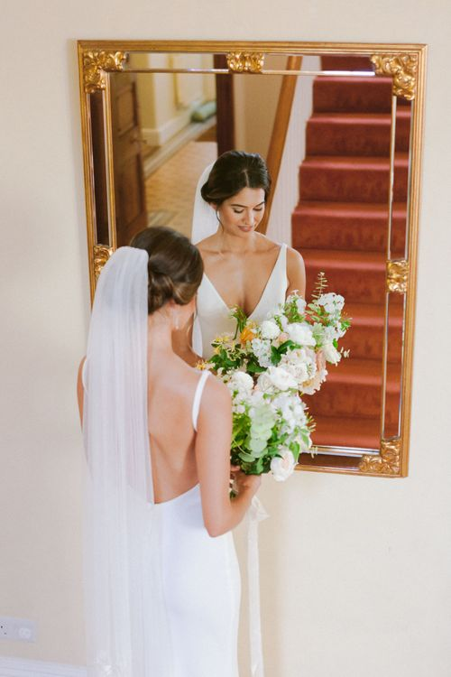 Cathedral veil with lace detail  and open back wedding dress