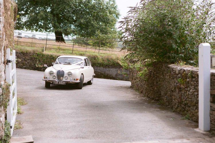Vintage wedding car arriving at Shilstone House wedding ceremony