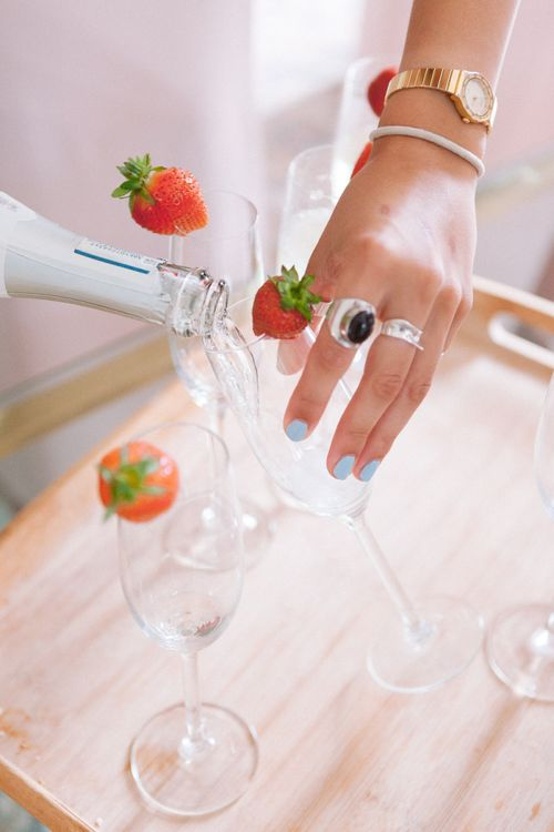 Pouring champagne during preparations at Shilstone House wedding