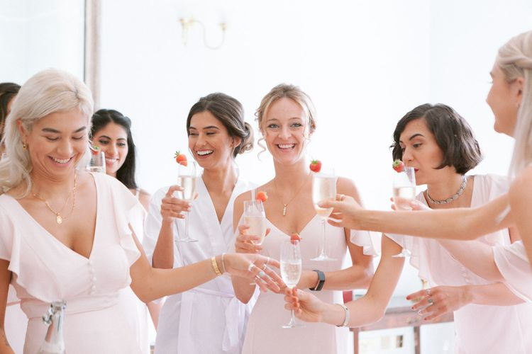 Bridal party preparations toasting the big day