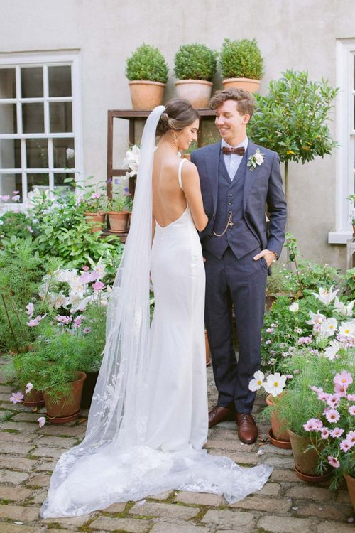 Simple Made With Love bride dress with open back and long veil