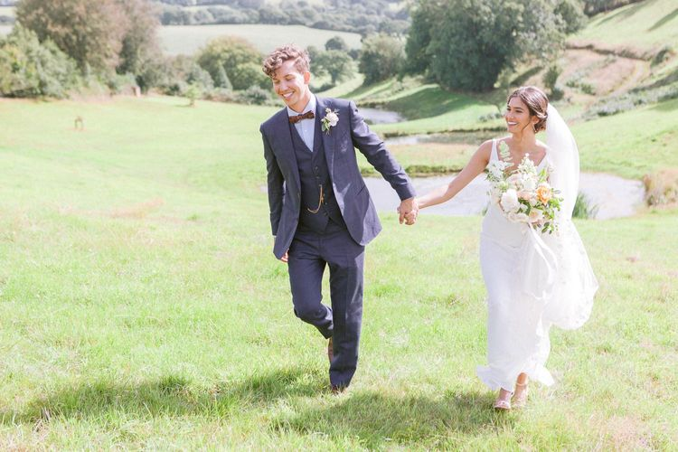 Groom in navy suit and bowtie at Shilstone House wedding