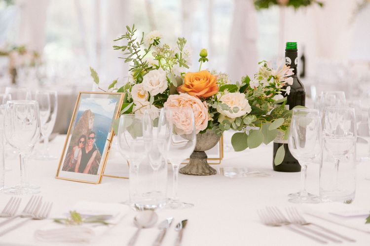 Table centrepieces with blush and peach roses