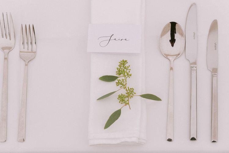 Foliage wedding table decor and place setting names