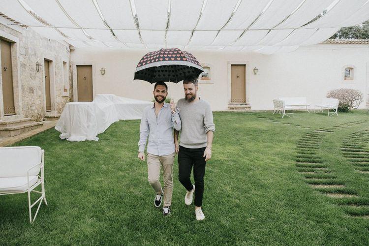 Grooms arrive at wedding venue