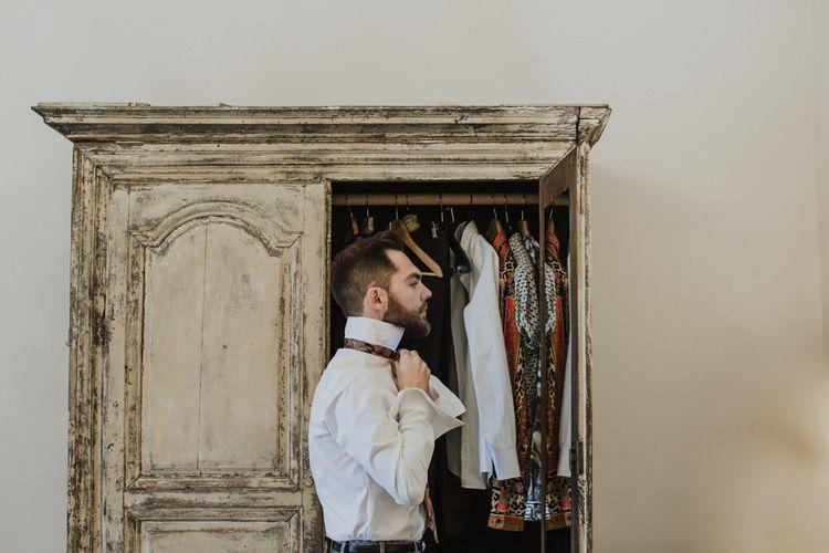 Groom getting ready for Sicily wedding