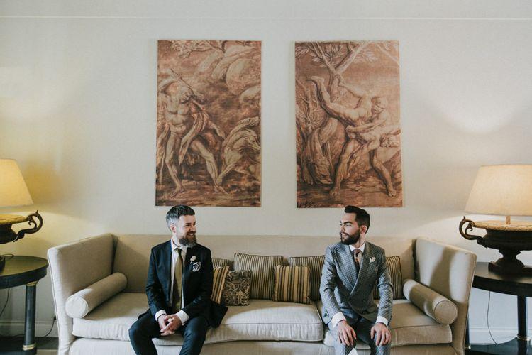 Grooms get ready for wedding in grey groom suit