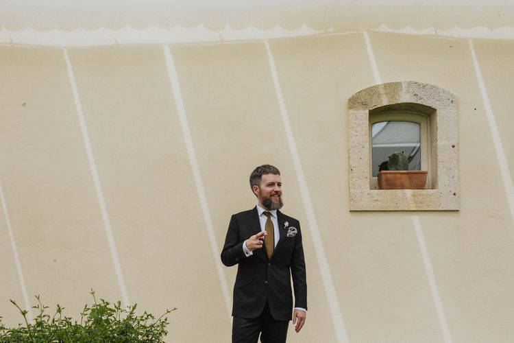 Groom prepares for wedding ceremony