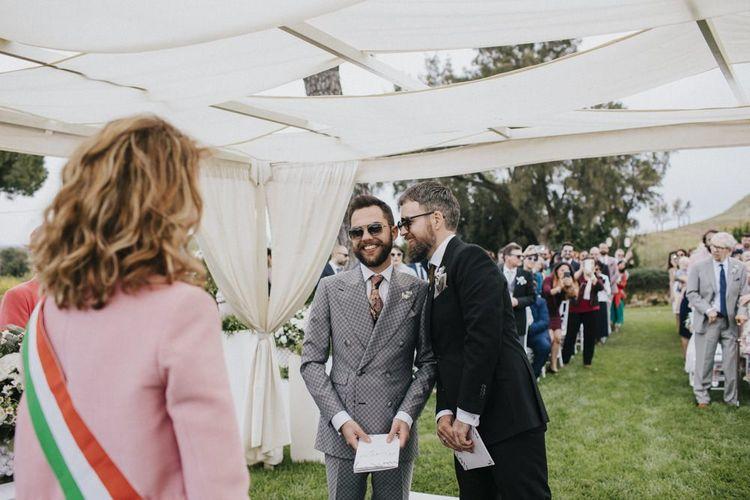 Grey groom suit for outdoor wedding ceremony