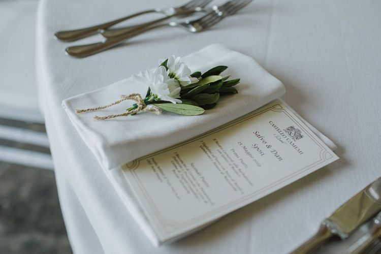 Wedding place setting with olive branch
