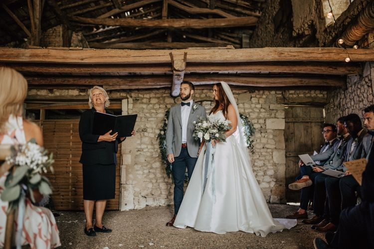 Humanist wedding ceremony with bride in strapless Sassi Holford wedding dress