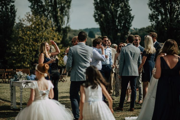 Outdoor drinks reception at French destination wedding