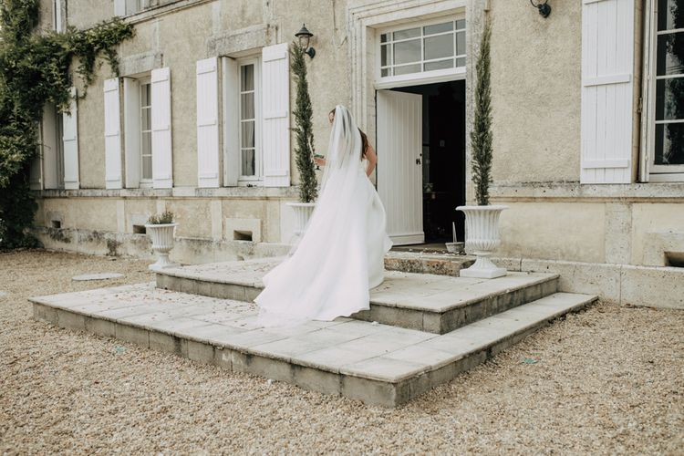 Bride in princess wedding dress and cathedral veil