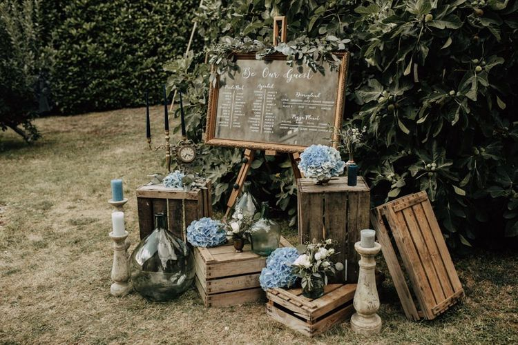 Rustic crate wedding decor and mirror table plan
