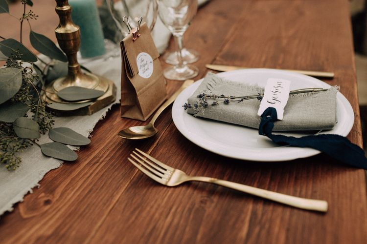Rustic place setting with gold cutlery