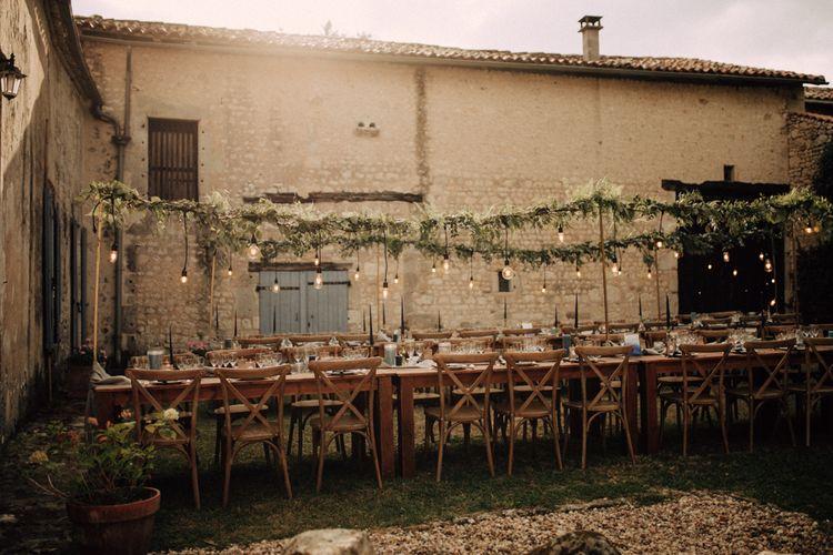 Outdoor wedding reception table decor at Maison de la Vaure, Chillac, France