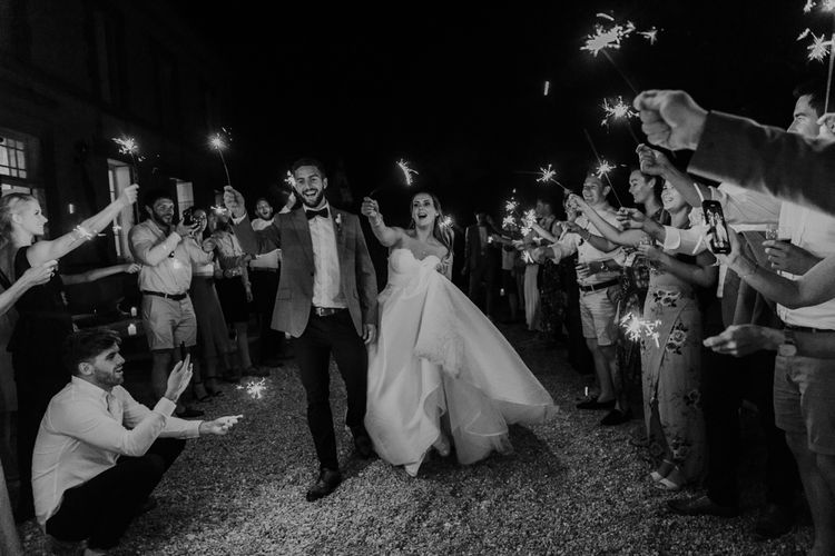 Sparkler moment with bride in strapless Sassi Holford wedding dress