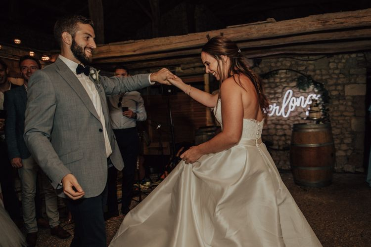 Bride and groom first dance with bride in Sassi Holford wedding dress