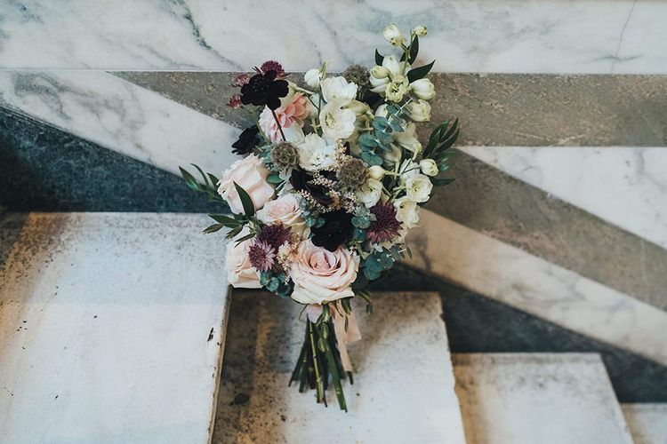Wedding bouquet with burgundy, apricot and dusky pink autumnal flowers