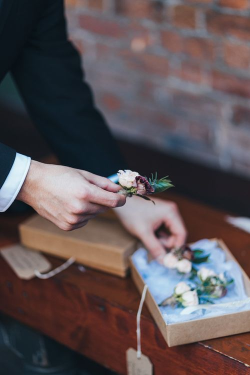 Buttonhole autumnal wedding flowers with burgundy and dusky pink detail