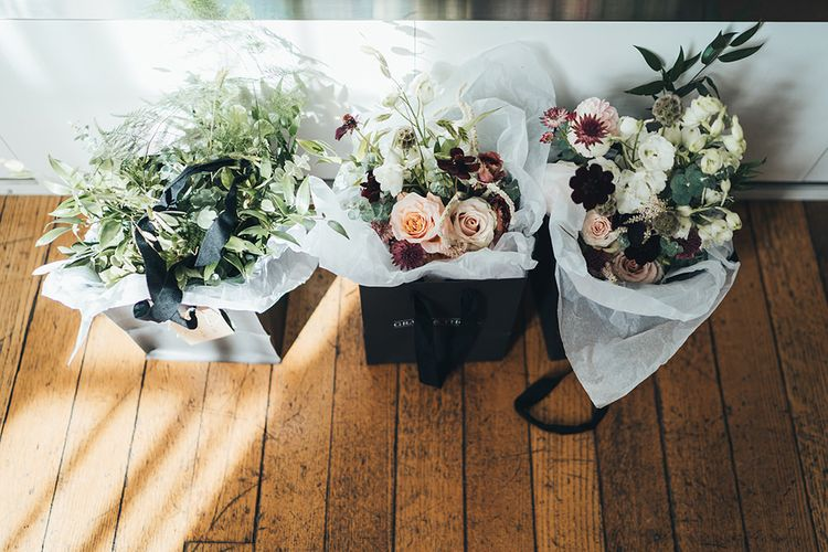 Autumn wedding bouquets using apricot, white and burgundy flowers for city wedding