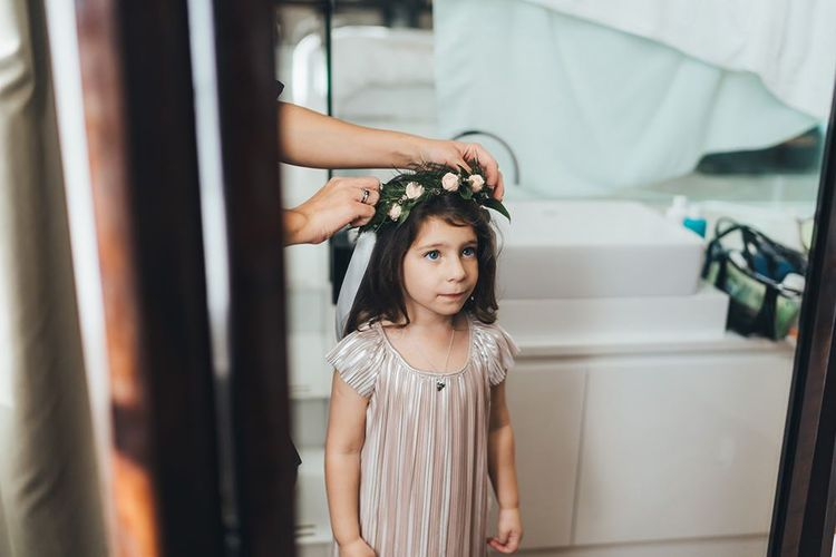 Flower girl with dusky pink floral head crown and nude dress with black bridesmaid dresses at city wedding