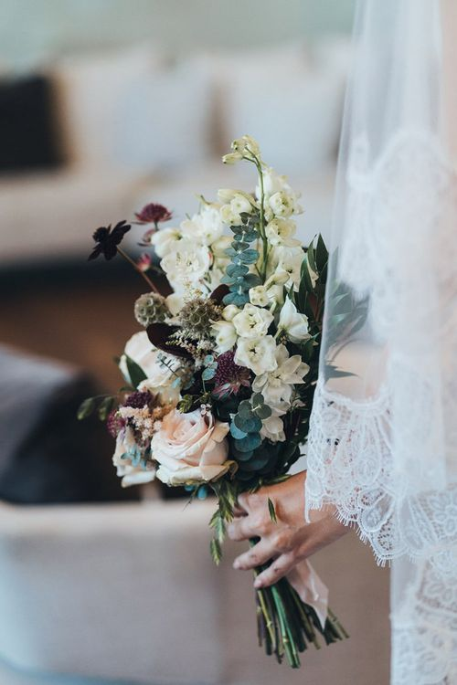 Autumn themes wedding bouquet with white, apricot and burgundy flowers