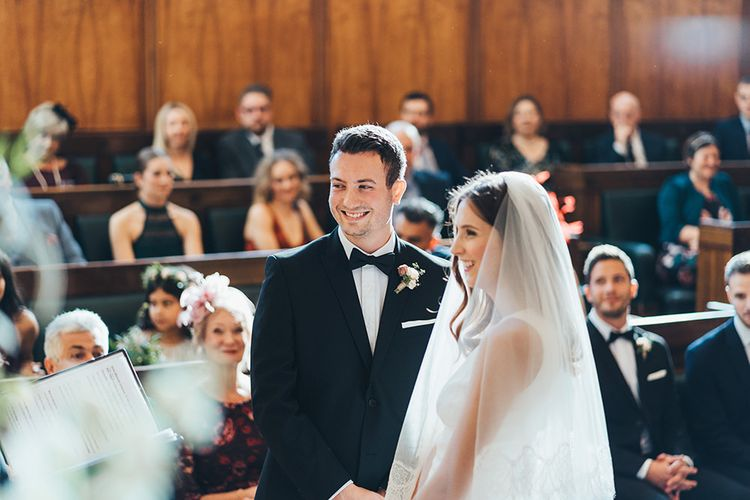 Bride and Groom at East London wedding ceremony with black bridesmaid dresses
