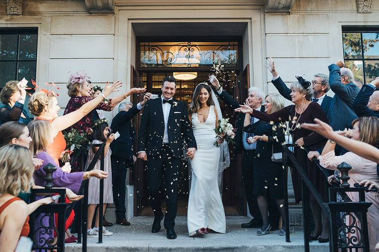 Bride and Groom confetti shot with black bridesmaid dresses