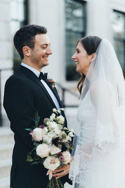 Elegant city London wedding with black tie fashion and black bridesmaid dresses
