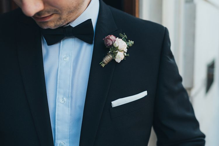 Black tie wedding with apricot and burgundy buttonhole flowers