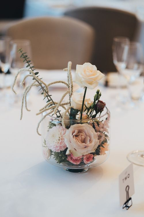 White and dusky pink floral centrepieces for relaxed and elegant city wedding