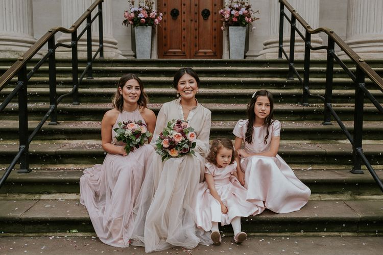 Bridal party at intimate London wedding with bride in tulle skirt