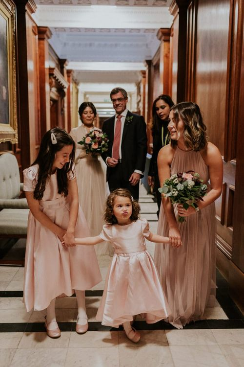 Bridesmaid and flower girls in pink dresses