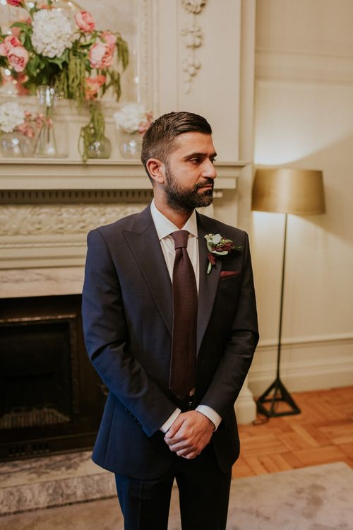 Groom in navy suit at town hall wedding