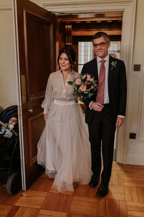 Wedding ceremony bridal entrance in tulle skirt