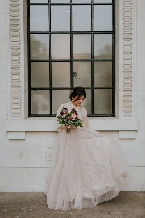 Bride in blush tulle skirt and top bridal separates