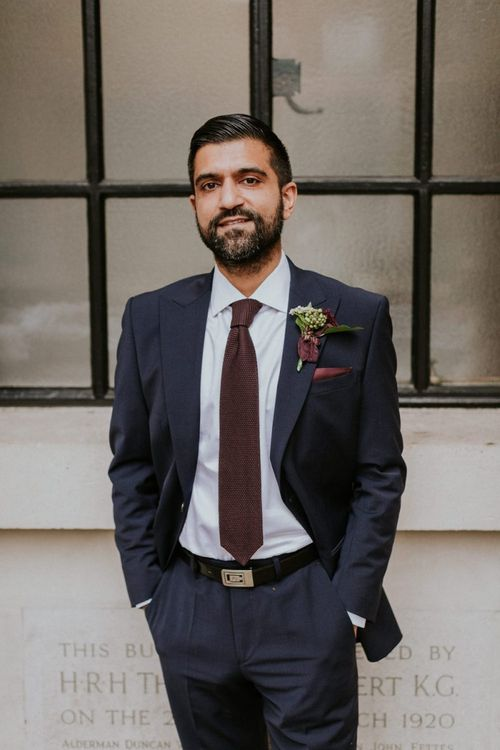Groom in navy suit and burgundy tie at Town Hall wedding