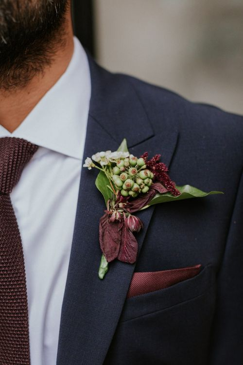Berry buttonhole with deep red foliage