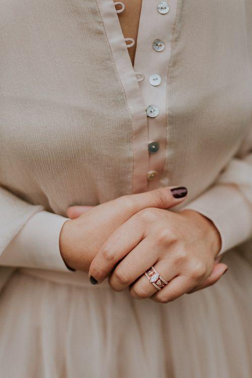 Ornate wedding ring and burgundy wedding nails