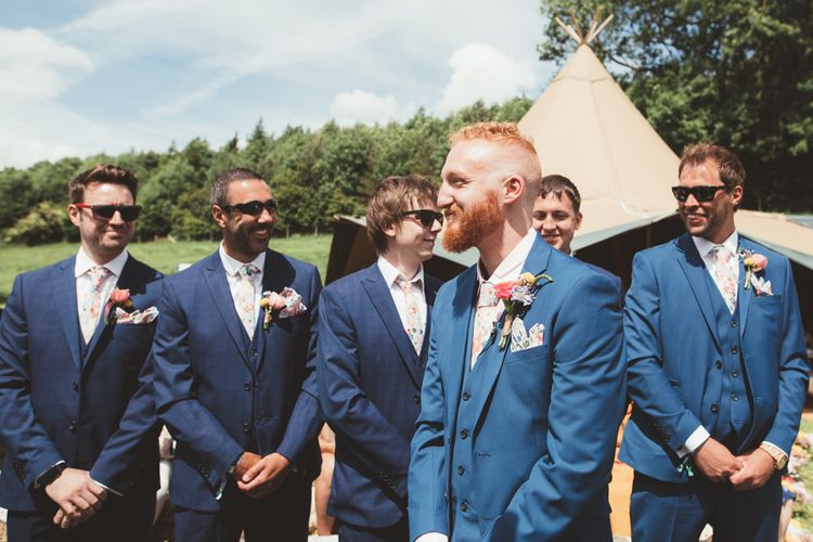 Groom at the altar in Navy Suit | Bright Festival Themed Outdoor Ceremony & Tipi Weeding |  Maryanne Weddings | Framed Beauty Film