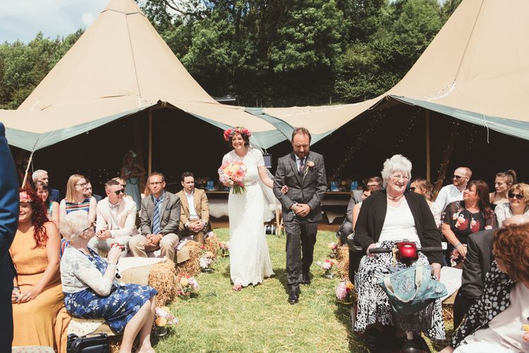 Wedding Ceremony | Bridal Entrance in Lace Watters Gown & Colourful Flower Crown | Bright Festival Themed Outdoor Ceremony & Tipi Weeding |  Maryanne Weddings | Framed Beauty Film