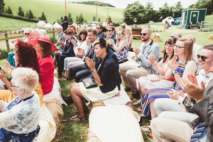Hay Bale Seating Area | Bright Festival Themed Outdoor Ceremony & Tipi Weeding |  Maryanne Weddings | Framed Beauty Film