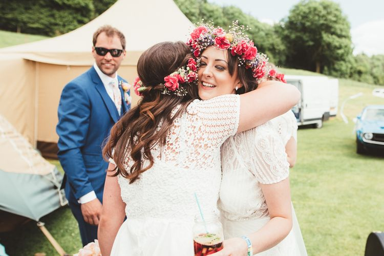 Bride in Lace Watters Gown & Colourful Flower Crown | Bright Festival Themed Outdoor Ceremony & Tipi Weeding |  Maryanne Weddings | Framed Beauty Film