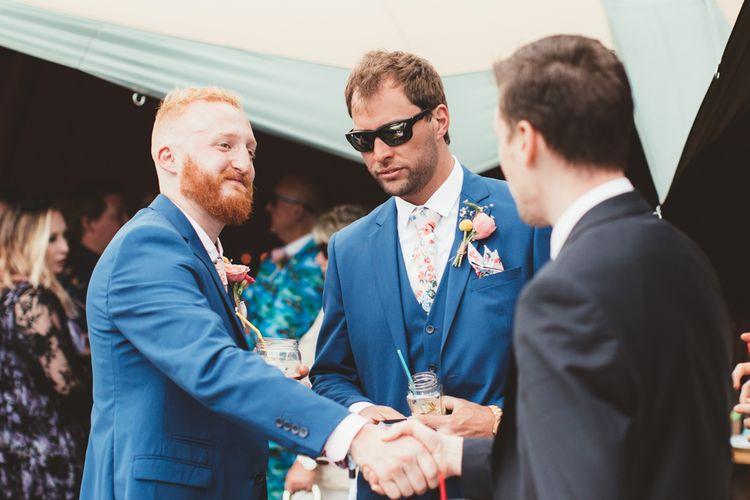Groom in Navy Suit | Bright Festival Themed Outdoor Ceremony & Tipi Weeding |  Maryanne Weddings | Framed Beauty Film