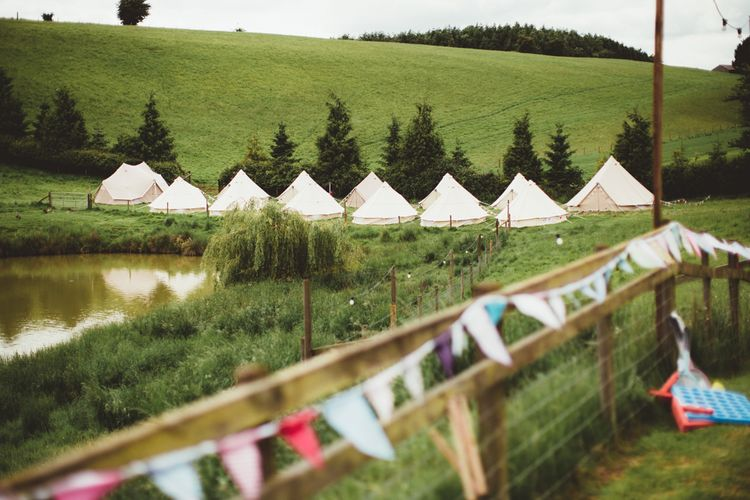 Bell Tent Glamping Field | Bright Festival Themed Outdoor Ceremony & Tipi Weeding |  Maryanne Weddings | Framed Beauty Film