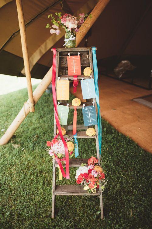 Vintage Step Ladder Table Plan | Bright Festival Themed Outdoor Ceremony & Tipi Weeding |  Maryanne Weddings | Framed Beauty Film