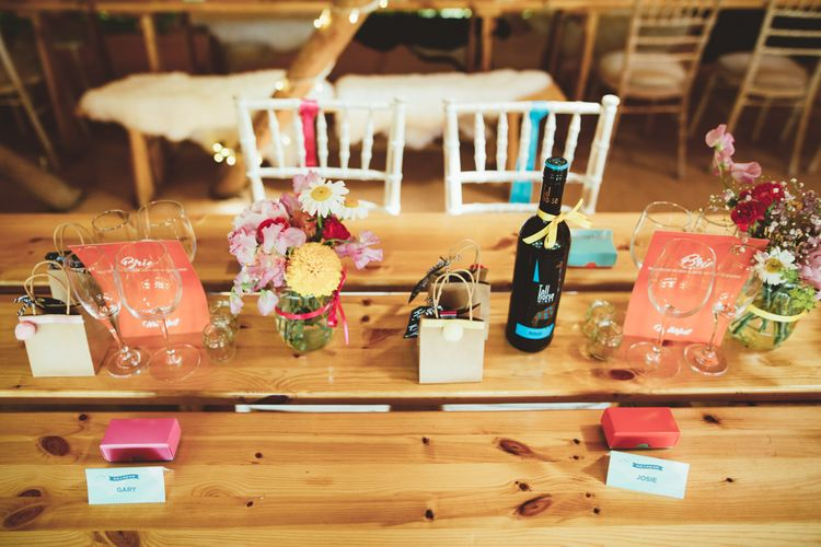 Table Decor with Flower Stems in Jars | Bright Festival Themed Outdoor Ceremony & Tipi Weeding |  Maryanne Weddings | Framed Beauty Film