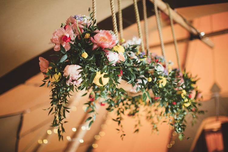 Floral Hanging Installation with Peonies | Bright Festival Themed Outdoor Ceremony & Tipi Weeding |  Maryanne Weddings | Framed Beauty Film
